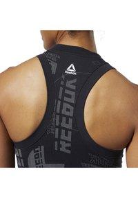 Reebok - MEET YOU THERE SEAMLESS CROPPED TANK TOP - Sports bra - black - 2