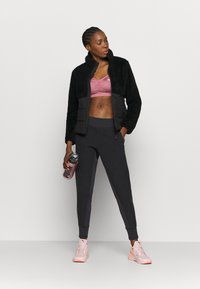 Puma - STUDIO FITTED PANT - Tracksuit bottoms - black - 1