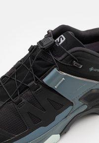 Salomon - X ULTRA 4 GTX - Hiking shoes - black/stormy weather/opal blue - 5