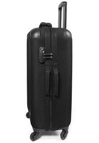Eastpak - TRANZSHELL/CORE COLORS - Wheeled suitcase - black - 3