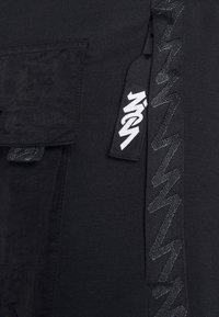 Jordan - ZION WILLIAMSON PANT - Spodnie treningowe - black/white - 5