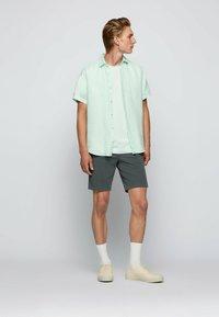 BOSS - SCHINO - Shorts - dark green - 1