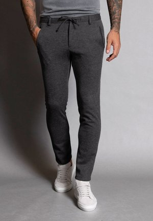 NEW SPARTAKUS - Trousers - grau