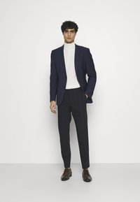 Calvin Klein Tailored - BI-STRETCH SUBTLE CHECK PANT - Trousers - navy - 1