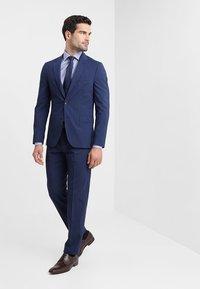 Tommy Hilfiger Tailored - Pantaloni eleganti - blue - 1