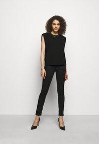 Emporio Armani - Jeans Skinny Fit - black - 1