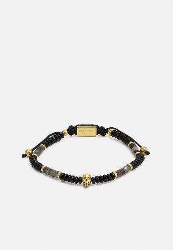SHEEN ONSIDIAN ATTICUS SKULL MACRAMÉ BRACELET UNISEX - Rannekoru - black/gold-coloured