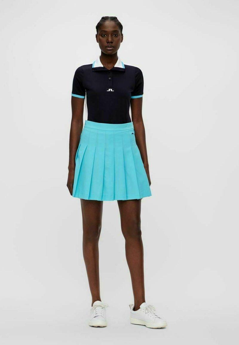 J.LINDEBERG - ADINA - Sports skirt - beach blue