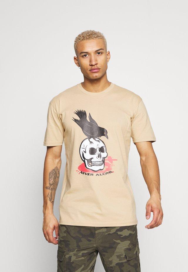 T-shirt z nadrukiem - tan