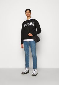 MOSCHINO - Sweatshirt - black - 1