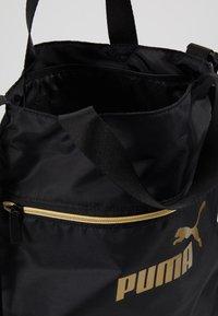 Puma - CORE SEASONAL SHOPPER - Tote bag - black/gold - 4
