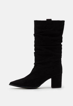 BENETTBO - Boots - black