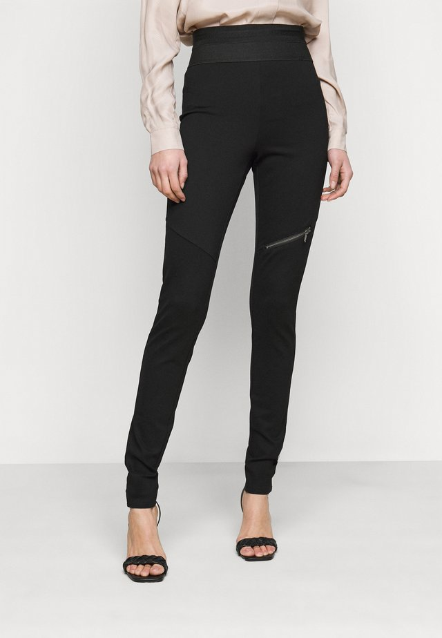 NMJACKS - Leggingsit - black