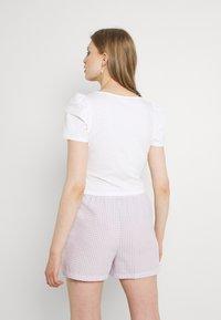 Monki - TELMA - Print T-shirt - white - 2