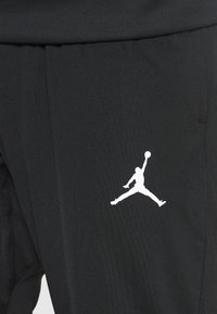 Jordan - AIR PANT - Verryttelyhousut - black/white - 4