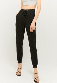 TALLY WEiJL - Teplákové kalhoty - black - 0