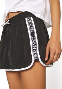 Calvin Klein Swimwear - CORE LOGO TAPE - Bikini bottoms - black - 3