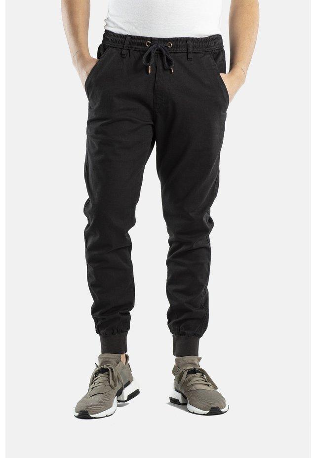 REFLEX RIB - Trousers - 120 black