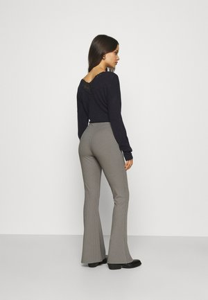 SPLIT HEM FLARE - Pantalones - dark grey