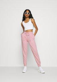 Nike Sportswear - PANT - Pantalon de survêtement - pink glaze/white - 1