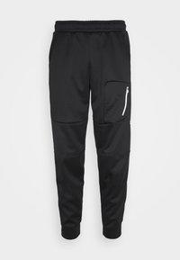 Puma - EVOSTRIPE WARM PANTS - Pantalon de survêtement - black - 3