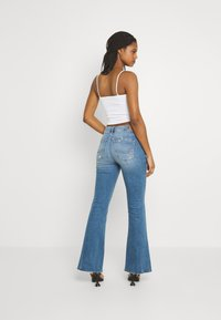 American Eagle - SUPER HIGH RISE - Flared Jeans - cool hand blue - 2