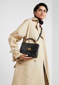 Coccinelle - LIYA MINI SATCHEL - Handbag - noir - 1