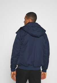Tommy Jeans - TECH BOMBER UNISEX - Winter jacket - twilight navy - 3