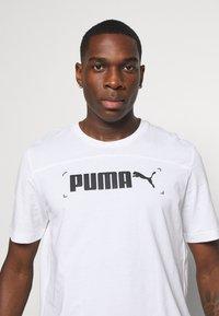 Puma - NU TILITY GRAPHIC - T-shirt med print - white - 4