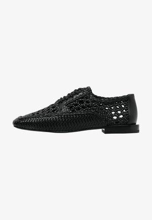 HELI - Sportieve veterschoenen - total black