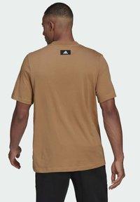 adidas Performance - Print T-shirt - brown - 1