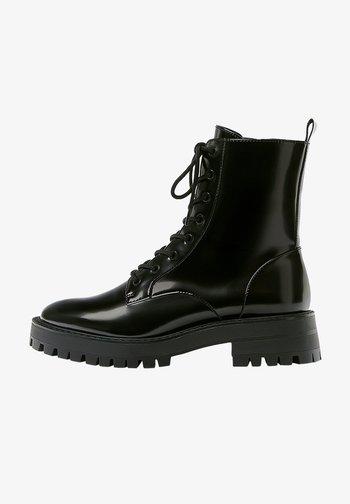 LACKOPTIK - Platform ankle boots - black