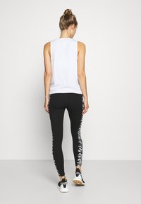 DKNY - HIGH WAIST ZEBRA PLACED PRINT - Leggings - white