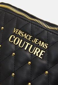 Versace Jeans Couture - MALLORY BELTBAG - Bum bag - nero - 4