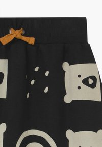 Turtledove - RAIN BEAR HAREMS - Pantalon classique - black - 3