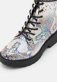 Steve Madden - JTORNADO - Lace-up ankle boots - beige - 5