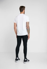 adidas Performance - RUN  - Collants - black/white - 2