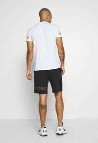 Björn Borg - MEDAL SHORTS - Sports shorts - black gold - 2
