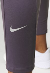 Nike Performance - WARM PANT RUNWAY - Tracksuit bottoms - dark raisin/reflective silver - 3