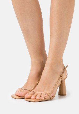 JESSY - T-bar sandals - nude
