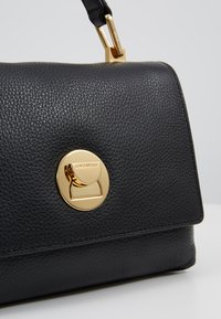 Coccinelle - LIYA MINI SATCHEL - Handbag - noir - 6