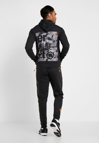 Superdry - COMBAT BOXER JOGGER - Tracksuit bottoms - black - 2