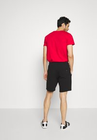 Tommy Hilfiger - BASIC EMBROIDERED  - Shorts - black - 2