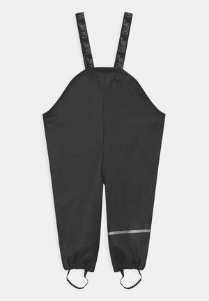 RAINWEAR PANTS SOLID UNISEX - Rain trousers - black