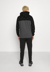 Glorious Gangsta - HERVOS JOGGERS - Tracksuit bottoms - black - 2