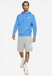 Nike Sportswear - CLUB HOODIE - Bluza z kapturem - light blue - 1