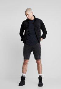 Calvin Klein Jeans - Szorty jeansowe - black with embro - 1