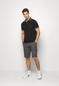 Tommy Hilfiger - Polo shirt - black - 1