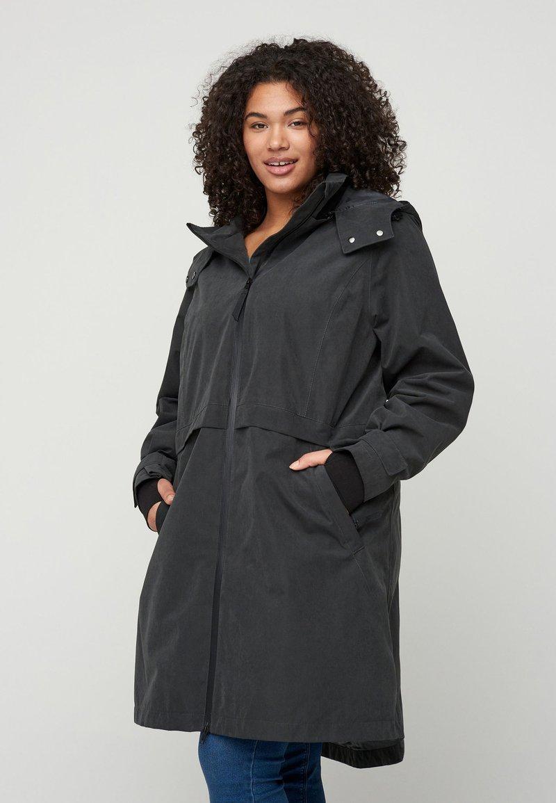 Zizzi - VERSTELLBARER - Waterproof jacket - black