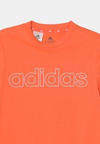 adidas Performance - UNISEX - Triko spotiskem - orange/white - 2